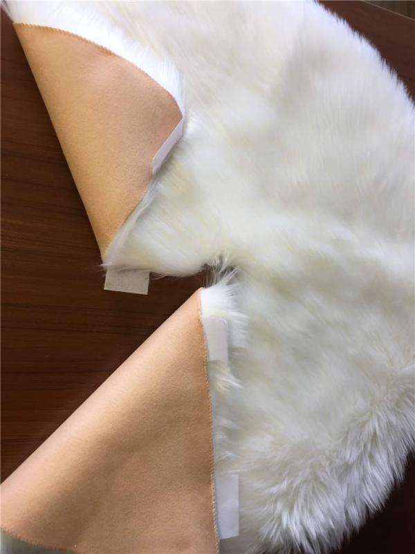 backside of white christmas tree skirt