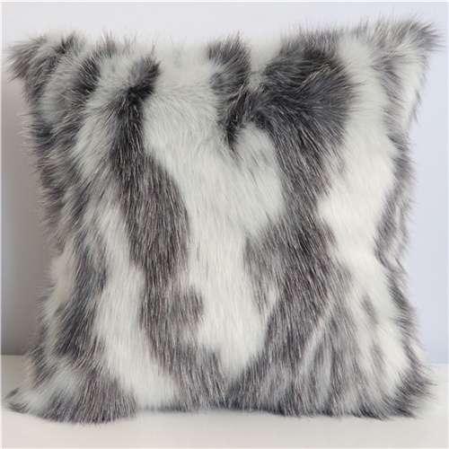 white and black fur cushion